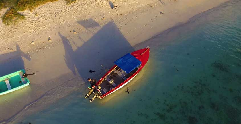 Fishing Beneath Coral Reef in a Rapid Boat or Pirogue – Rodrigues